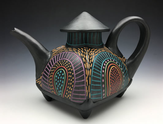 """My current work involves a combination of carving, slip inlay and slip trailing, with colored slips, underglazes, and oxide washes, sometimes including impressed texture. By using a variety of surface techniques I feel very engaged with the pot. After many years of using only impressed texture, I felt the urge to explore other methods of surface decoration. Now I often incorporate more than one technique on each piece. Slip trailing and slip inlay, while very challenging, are exciting for me because it is much like writing and drawing, two things I love to do. These techniques of applying designs by carving into, or putting on top of the surface, instead of imbedding into clay, have allowed me to explore texture in a whole new way.  I am inspired by the world around me. Nature, architecture, jewelry and bead design, pattern, especially fabric designs, are constant sources for me. I grew up around fabric and it continues to inspire my work. I have chosen to make functional pots because I appreciate food, celebration, and setting a beautiful table. In this """"age of communication,"""" where most communicating is done electronically, and so much food is being eaten out of paper, plastic or Styrofoam, my hope is to have my humanity show through my pots, by bringing some creative life into eating and drinking. A handmade pot contains the soul and energy of the maker, and when used, a human connection is made. These basic connections between people keep our souls alive."""