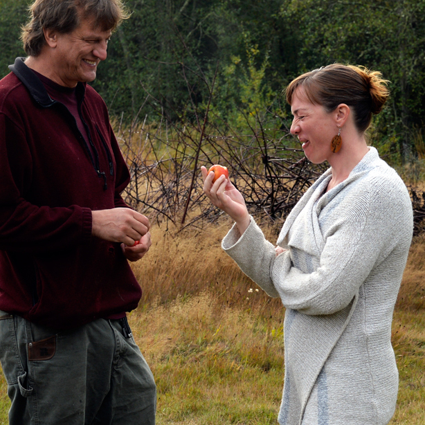 """Dragon's Head Cidermakers Wes and Laura Cherry sample a """"spitter"""", an affectionate name for cider apples that comes from the adage that advises:""""Take a bite: The worst it tastes — the farther you spit it — the better the cider it will make."""""""