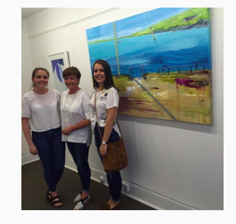 Helen O'Keeffe at the opening with her two daughters.