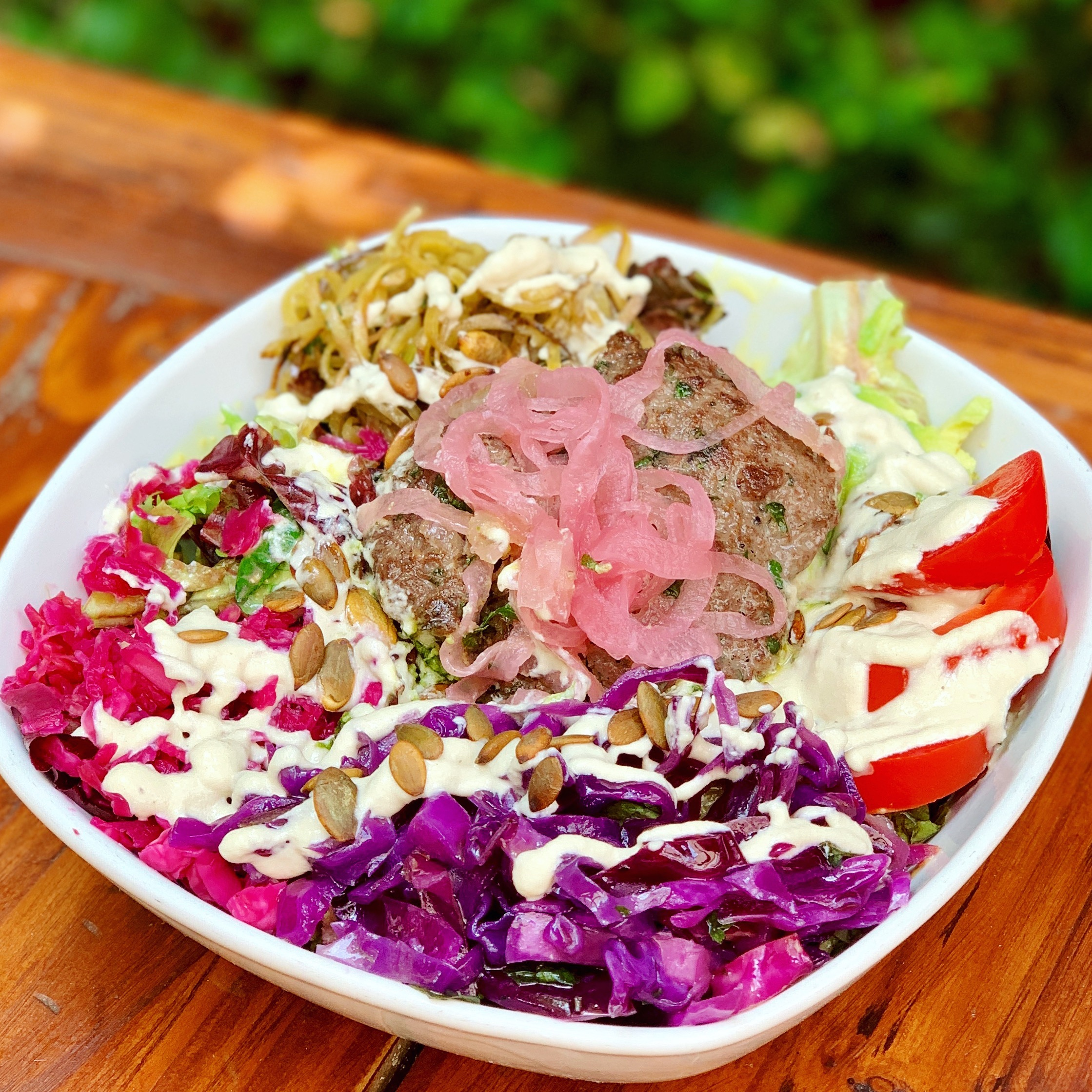 This bowl I ate on our baby moon in Ojai, CA was loaded with probiotics (there were several types of fermented veggies in there and not to mention all the different colors) and other pregnancy-friendly foods (hello grass-fed bison burger).
