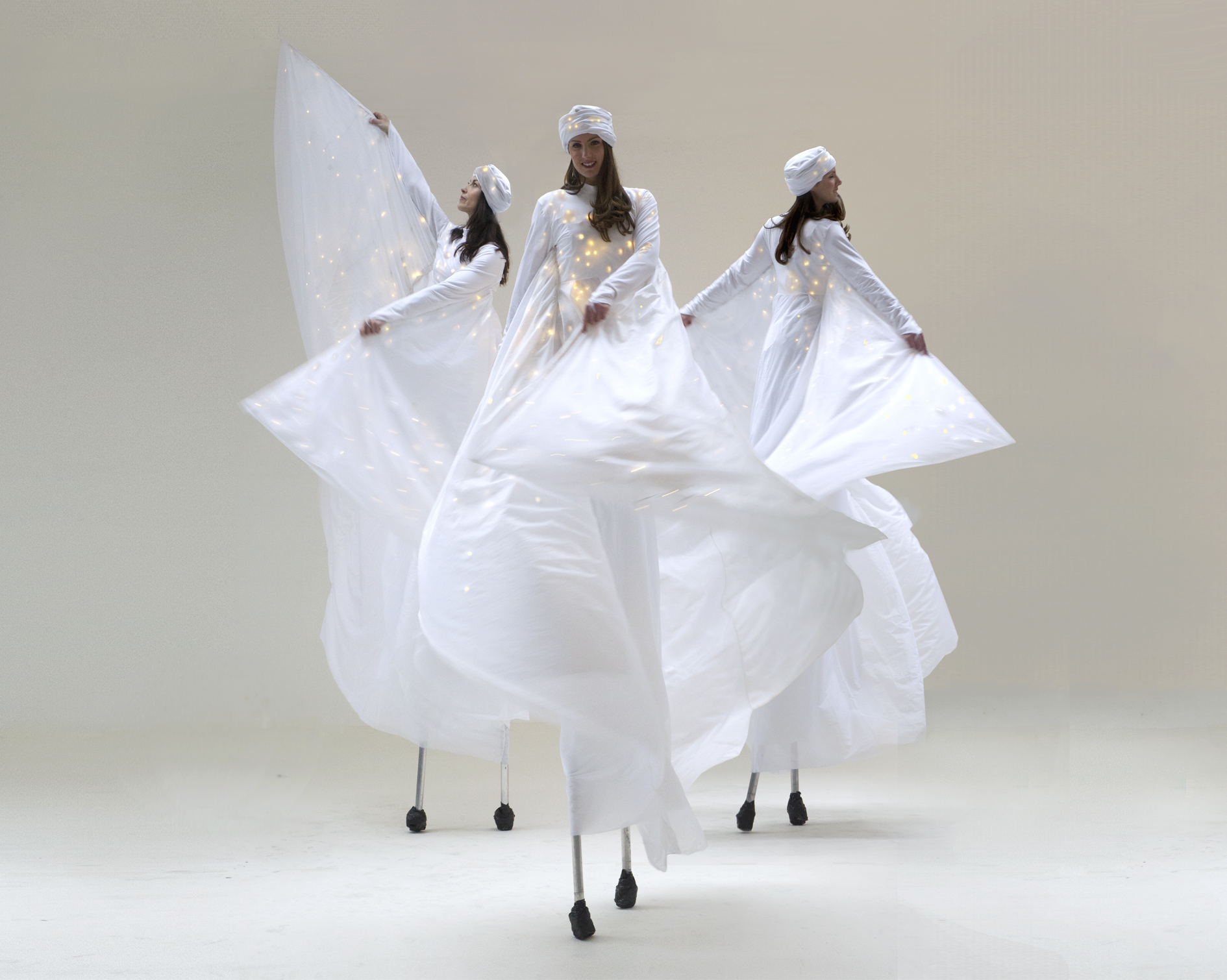 Optioscopes in white, stilt performance, Divine Company.jpg