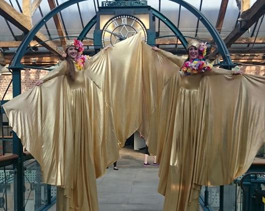 Optioscopes in gold, stilt performance 6, Divine Company.jpg