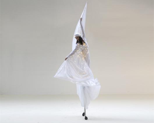 Optioscopes in white 2, stilt performance, Divine Company.jpg