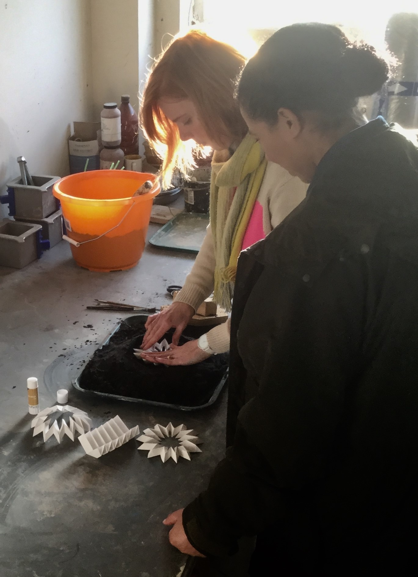 Hannah George shows presenter Margherita Taylor how sand casting paper art can make space for nature in built environment.