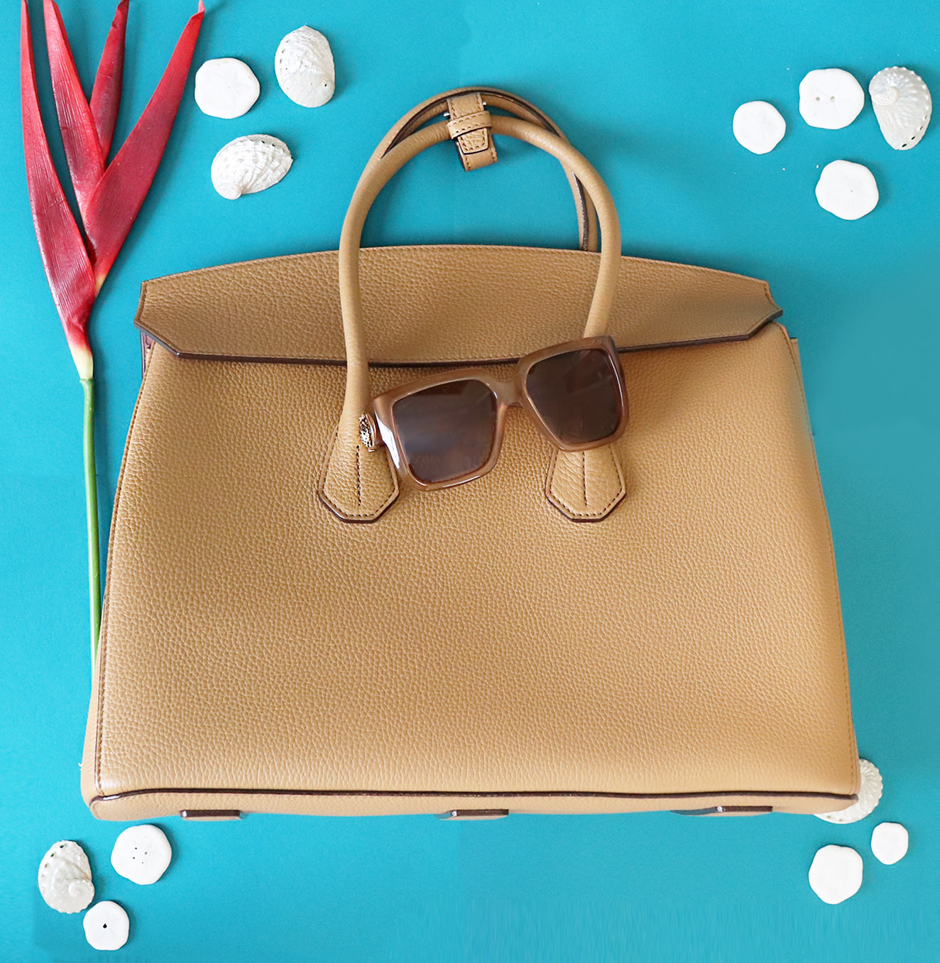 Buckle the sides in to create a new bag shape for spring and summer.