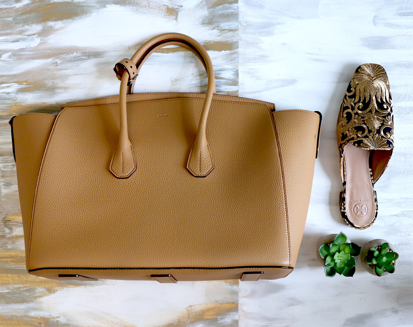 Have the sides open to have a wider handbag shape. Perfect for fall/winter and to toss in all your coats and layers.