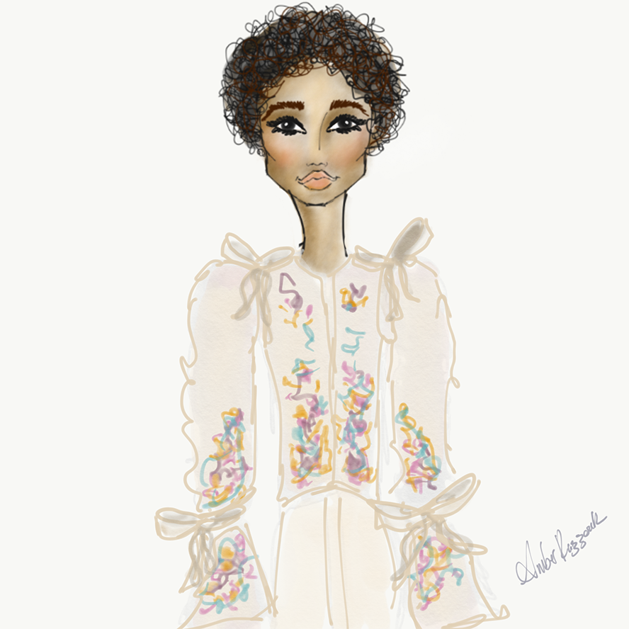 A stunning embroidered coat with huge bows that attached the sleeves.