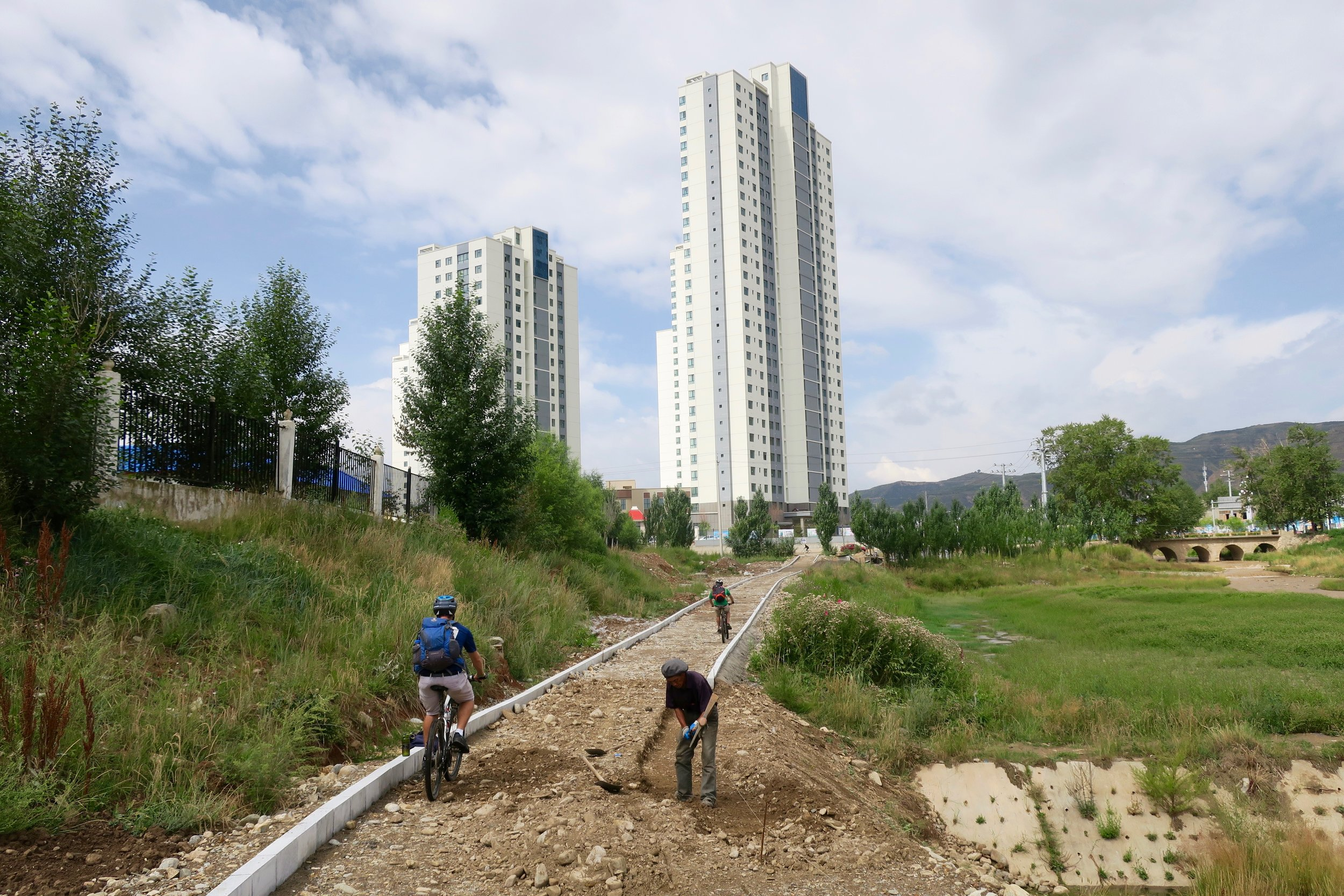 After the bikes were built, we headed into the city of Xining. The city is investing a huge amount of money in infrastructure. Bicycle paths across the city, world class sports fields, silky smooth roads.......