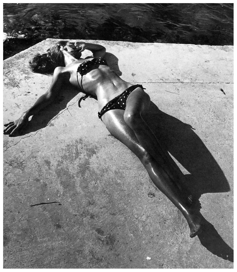 1946 bikini clad model Dovima in green and white polka dot by Carolyn Schnurer. Photo by Tondi-Frissell Montego Bay, Jamaica. Harpers Bazaar.