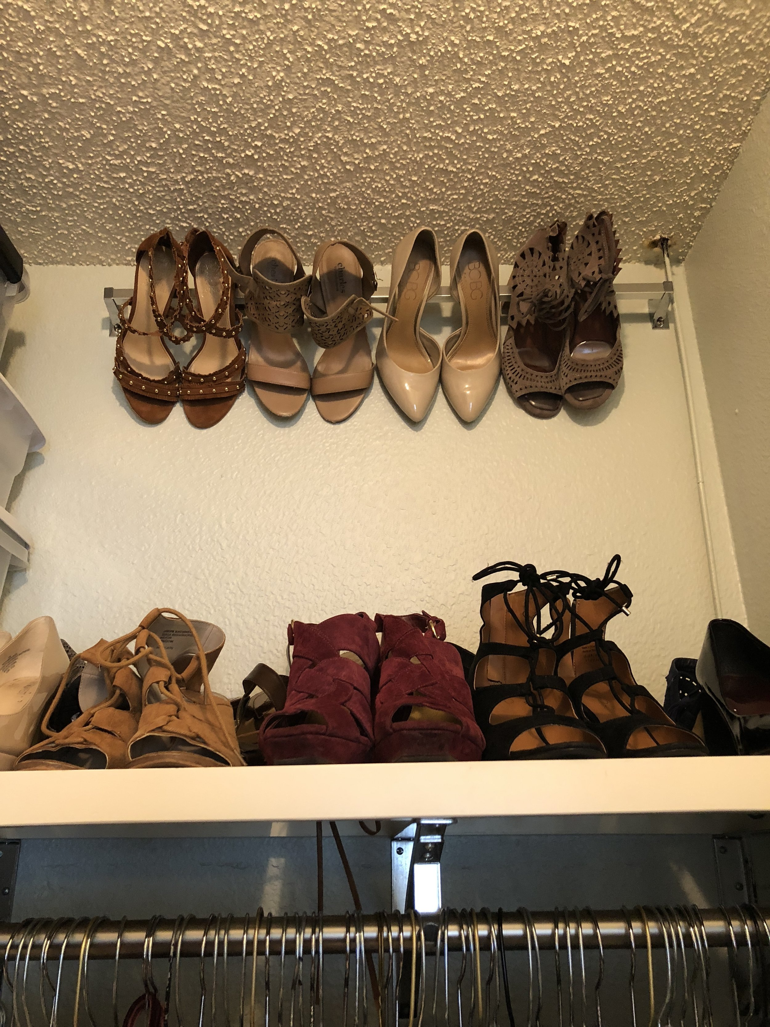 Shoes  Need extra shoe storage ladies? Try hanging a towel rod six inches from the ceiling and hook heels over that you don't use often. Men, try installing floating shelves.
