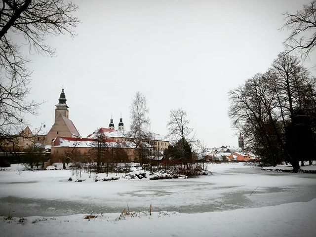 This weekend I've left my post in nitty gritty Prague for the snowy #UNESCO protected medieval hamlet of #Telč. Taking a reprieve from my more adventurous #travels, I've opted for a relaxing #getaway at a sleepy bed & breakfast in the town centre. Tourists and locals alike stroll at their leisure, taking in the Renaissance #architecture of the main square or sledding and wandering with pets and children in the hilly #park encircling the main roads. And while many of the billed attractions are shut up for the heavy #winter, I can scarcely imagine a better place to hole up in a wood and stone cafe, enjoying a steaming Svarene Vino (hot spiced wine) watching the snow fall on #Gothic gables and colorful #Romanesque façades.  If cost effectiveness is on your mind, #CZ continues to deliver: The bus trip from Prague was only €5, and the B&B for a single occupant, right on the main square, runs a little under €20 per night.  #outhereCZ #getoutthere #travel #CzechRepublic #instatravel #europe #europeantravel