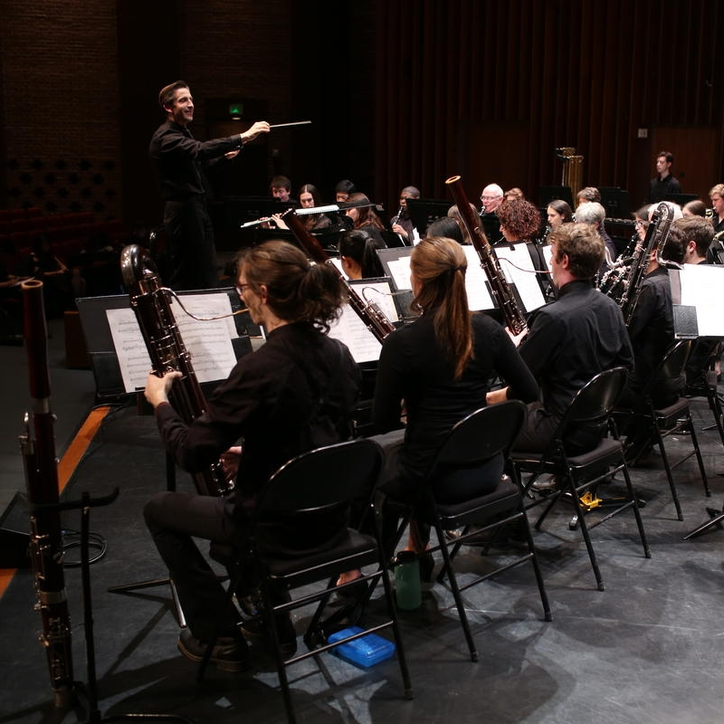 """NHPR: Upper Valley Wind Ensemble Looks to Break 'Brass Ceiling'    The Dartmouth College Wind Ensemble will celebrate women composers Saturday night with a concert featuring works exclusively by female artists. The show, titled """"Music, She Wrote…,"""" is one of several social-justice oriented performances this season at the Hopkins Center for the Arts."""
