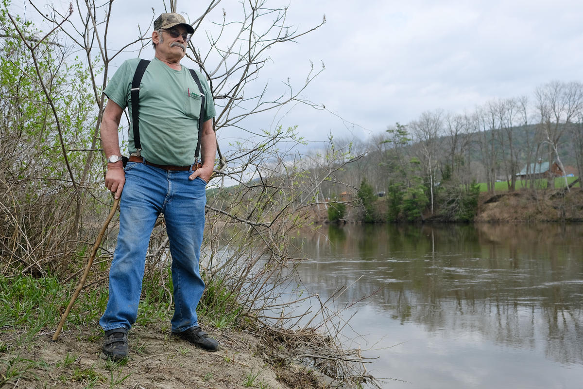 Steve Stocking has been farming the same land on the banks of the Connecticut River in Fairlee, Vermont for decades. He says rising and falling waters as a result of nearby dams are eroding his property — May 2018