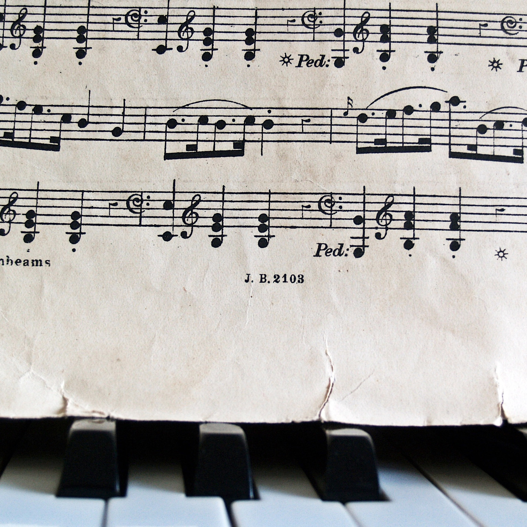 music-notes-and-sheet-music-on-a-piano.jpg