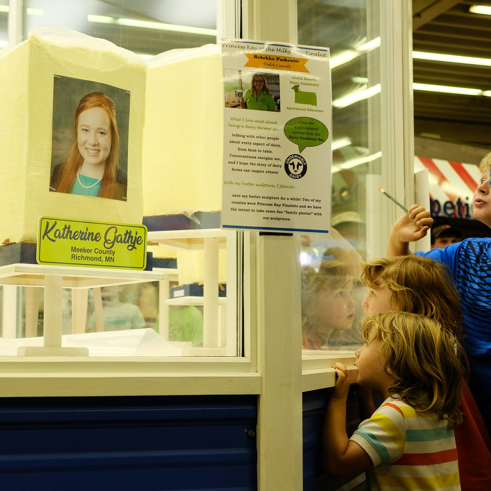 Every year at the Minnesota State Fair, county dairy princesses have their likenesses sculpted into butter. Here, kids check out the blocks of butter waiting to be carved — August 2018