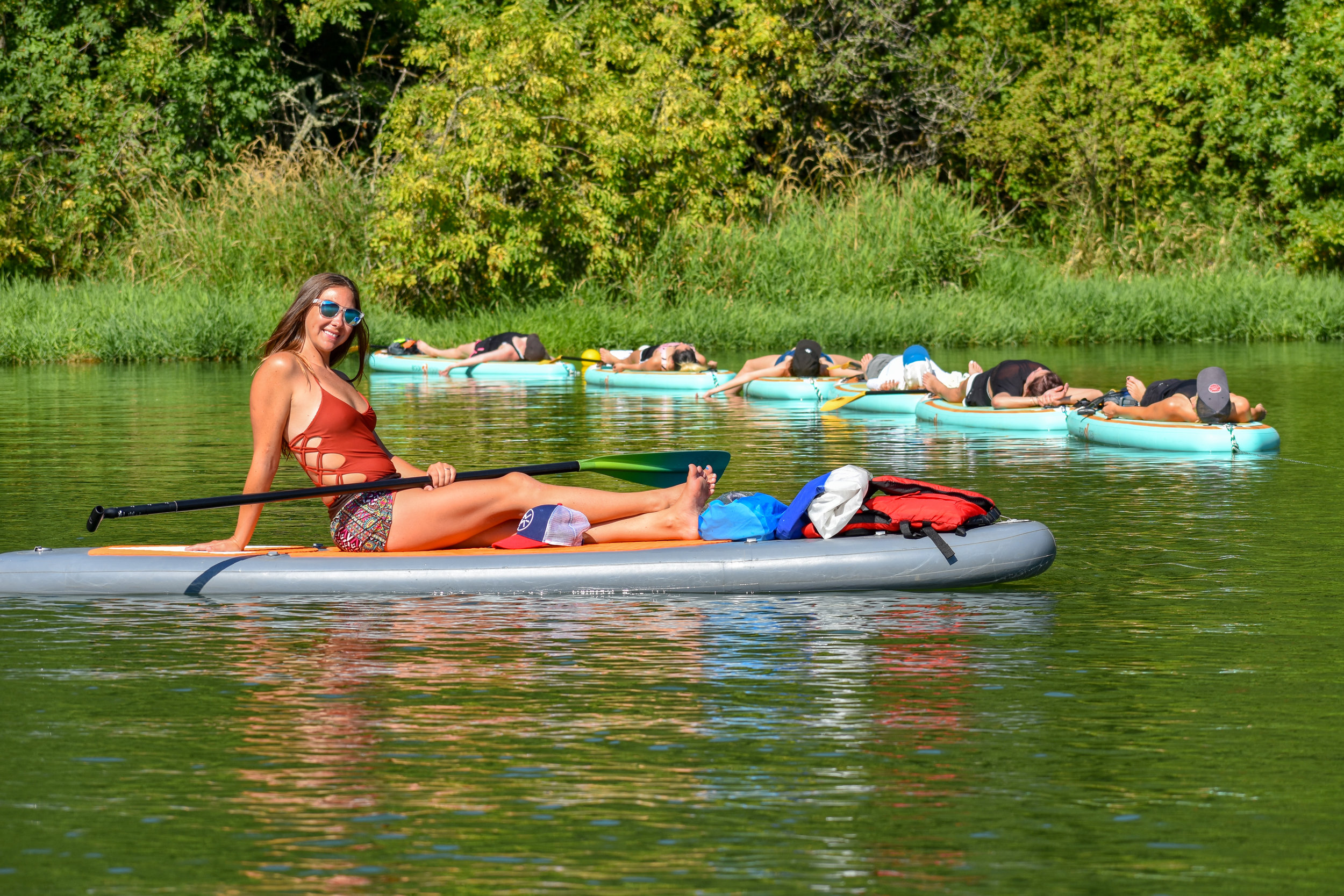 The Pump & Grind of SUP Yoga - Read our recent blog and gain a behind-the-scenes glimpse at teaching yoga on water!