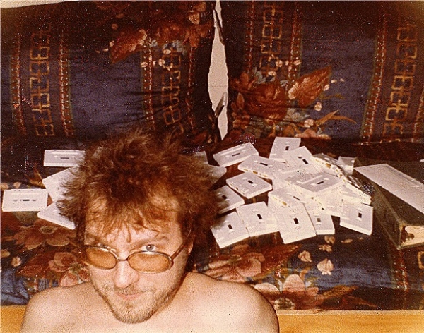 R. Stevie Moore and cassettes, cassettes, cassettes.Uncropped photo used for the trading card. Photo courtesy RSM