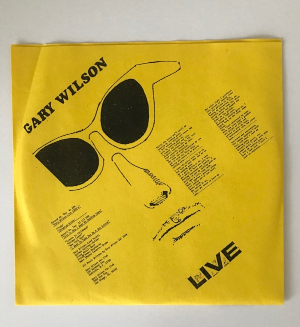 """The DIY back cover of WMF's Live at CBGB's copy, which includes """"fan club"""" addresses,credits, and the Gary Wilson poetry which appeared on This is Why I Wear My Wedding Gown"""