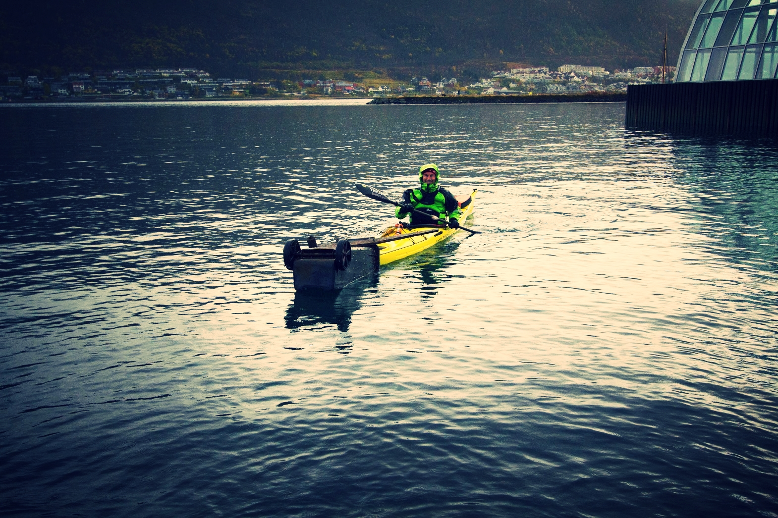 Kayakers from trulle (Simon) help collect underwater litter with divers from the Tromsø harbour during clean up operation, 2017, Photo Morgan Bender