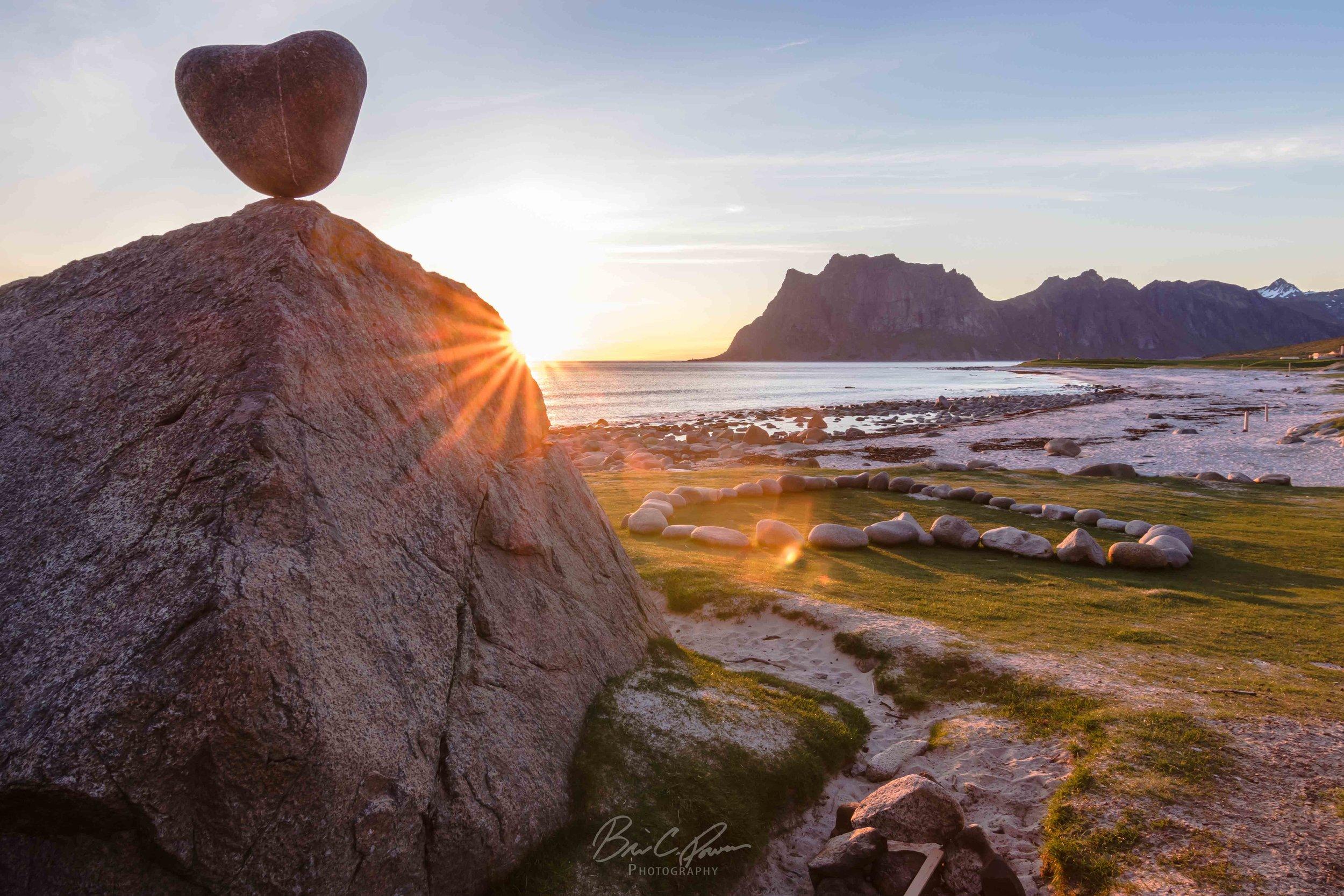 Heart shaped rock on beach in Lofoten Islands Norway