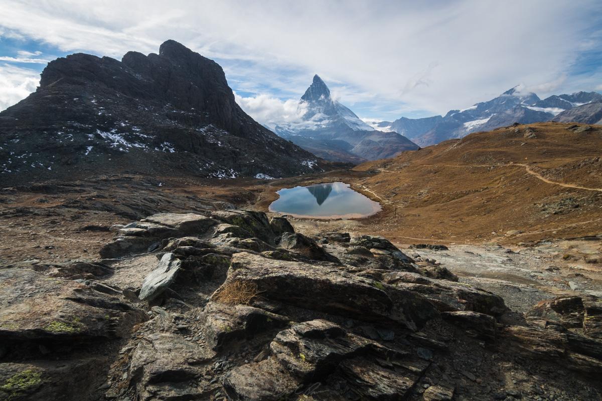 Riffelsee an alpine lake reflecting the prominent Matterhorn.