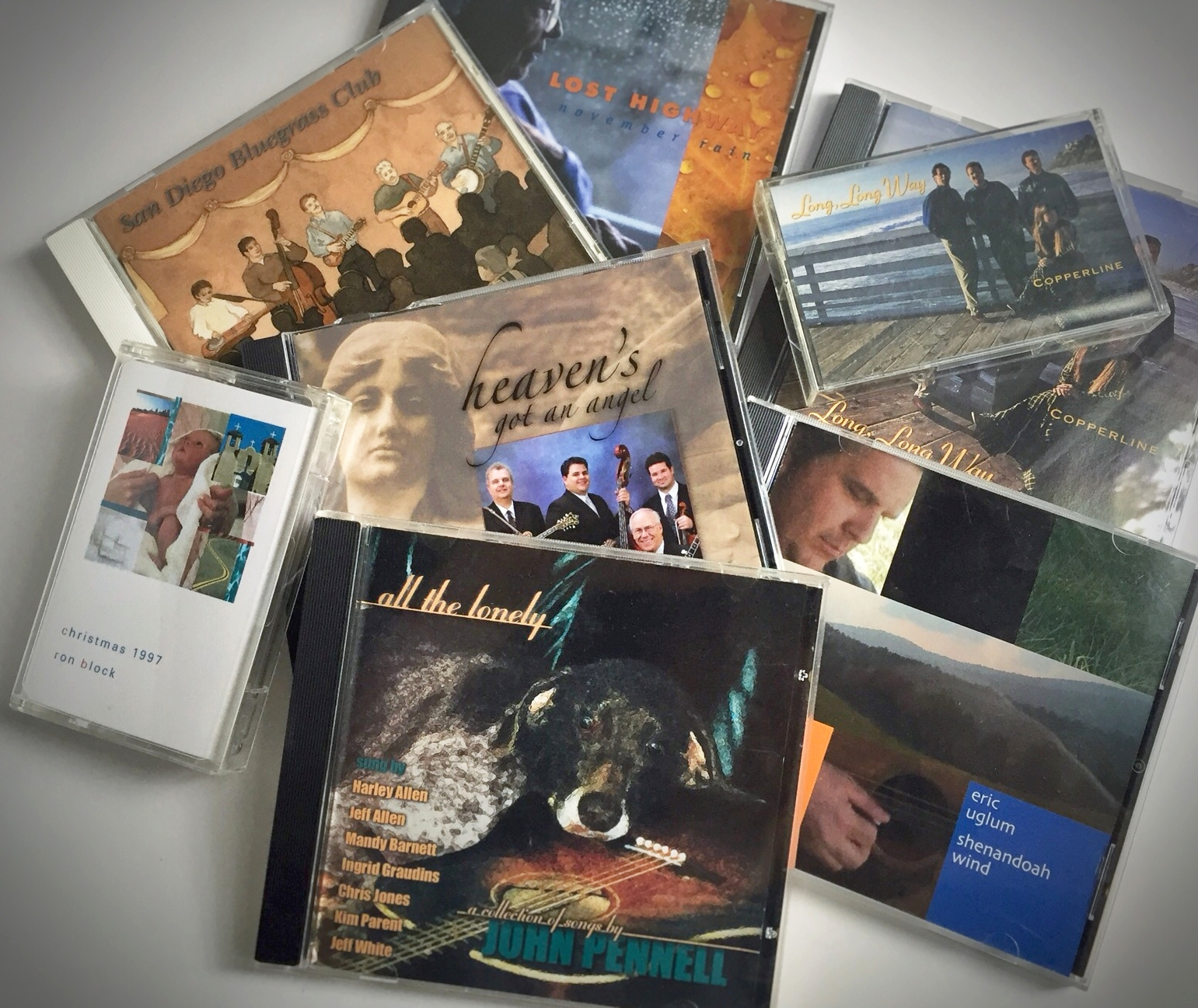 I've had a lot of fun creating CD and cassette tape packaging for musicians John Pennell, Eric Uglum, Ron Block, Copperline, Hwy 52, and the San Diego Bluegrass Club. Really getting to know the artists and the music allows me to match the images and design to their individual styles.