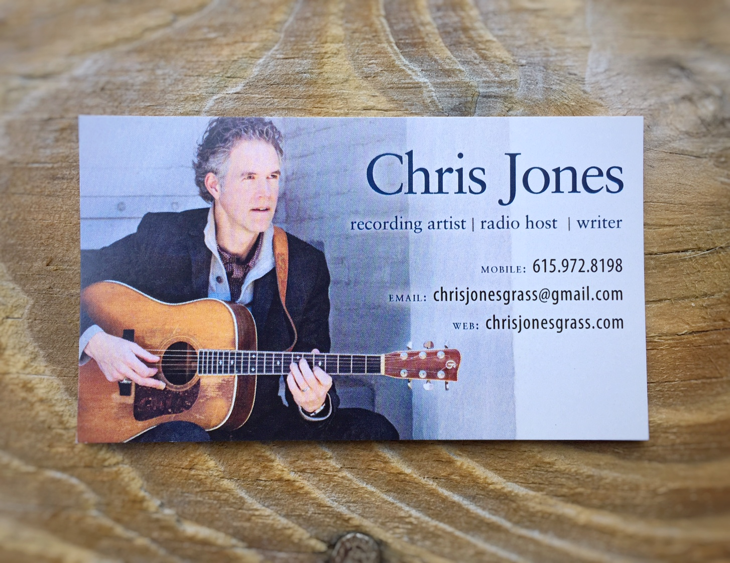 This business card for bluegrass musician Chris Jones needed to be done in a hurry. We produced the artwork in two-and-a-half hours from the time he called me to time it went off to the printers. My miraculous contacts at Printsource in Charlottesville, VA had the cards beautifully printed and delivered on the doorstep in just two business days, and gave us an amazing price. A good relationship with a professional printer is worth a fortune!