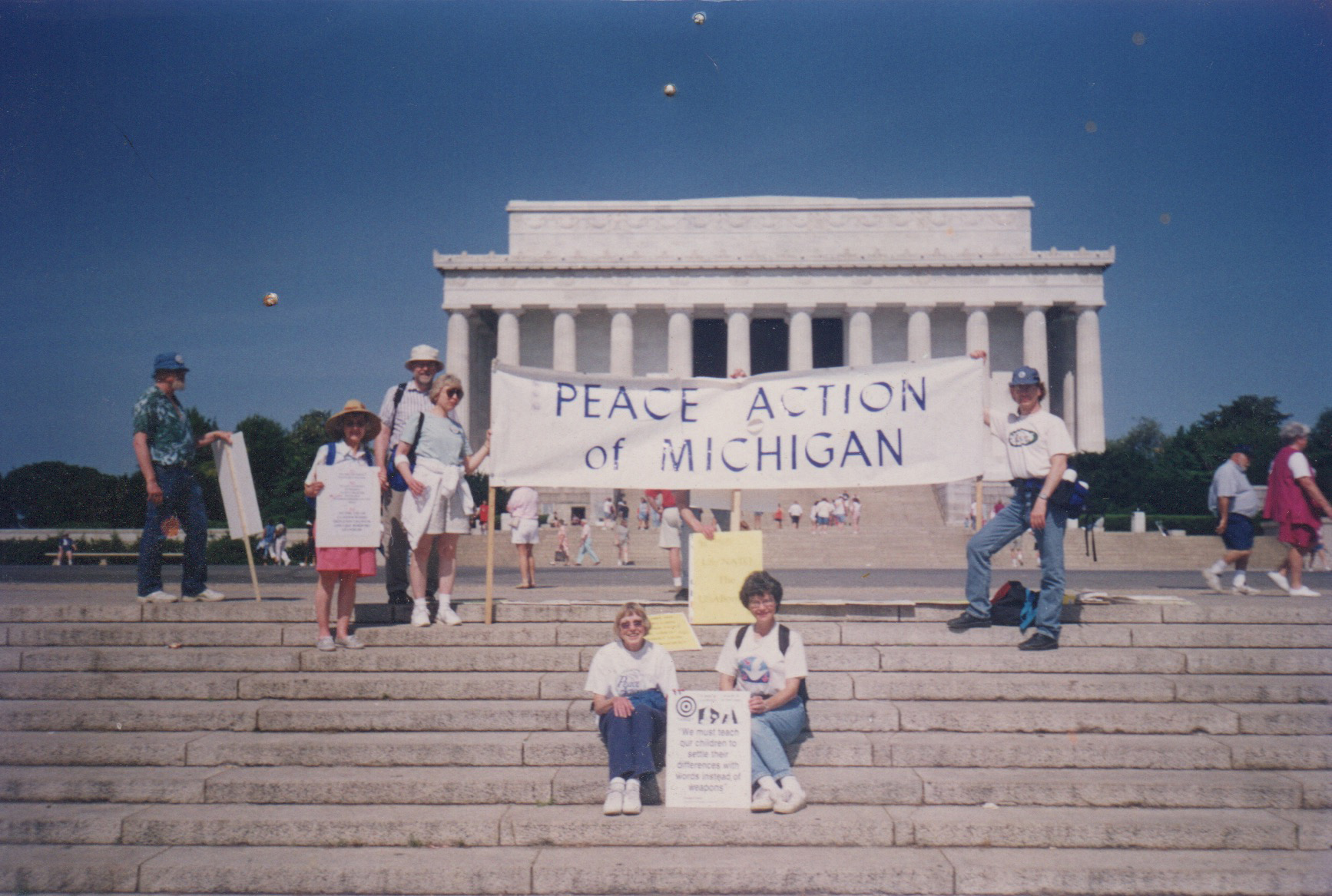 Pat Lent and Sister Rita Mary Olszewski with the Peace Action of Michigan banner in front of the Lincoln Memorial in Washington, DC.