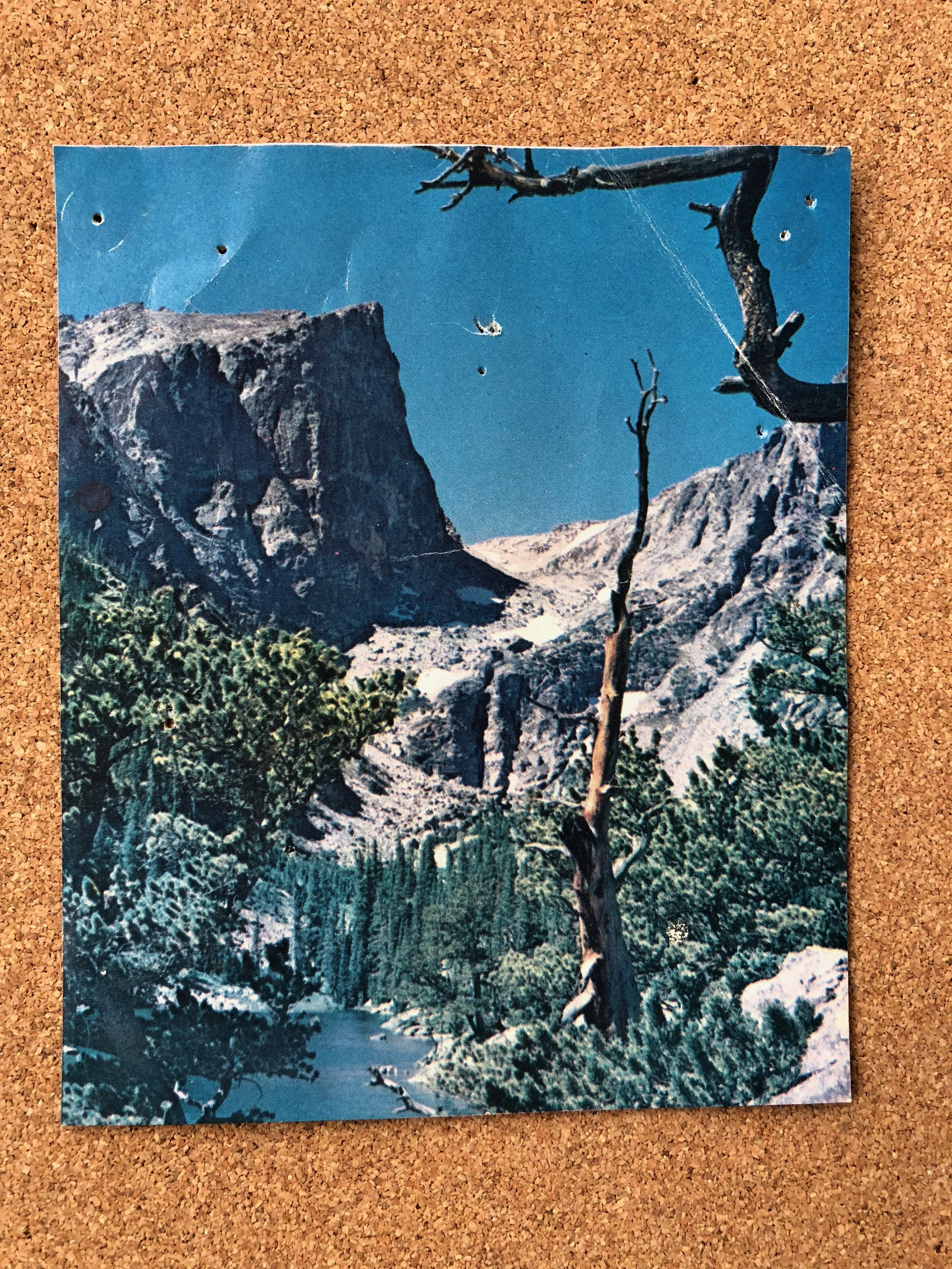 Photo of the mountains in Rocky Mountain National Park, Estes, Colorado. Cut from a trail map brochure.