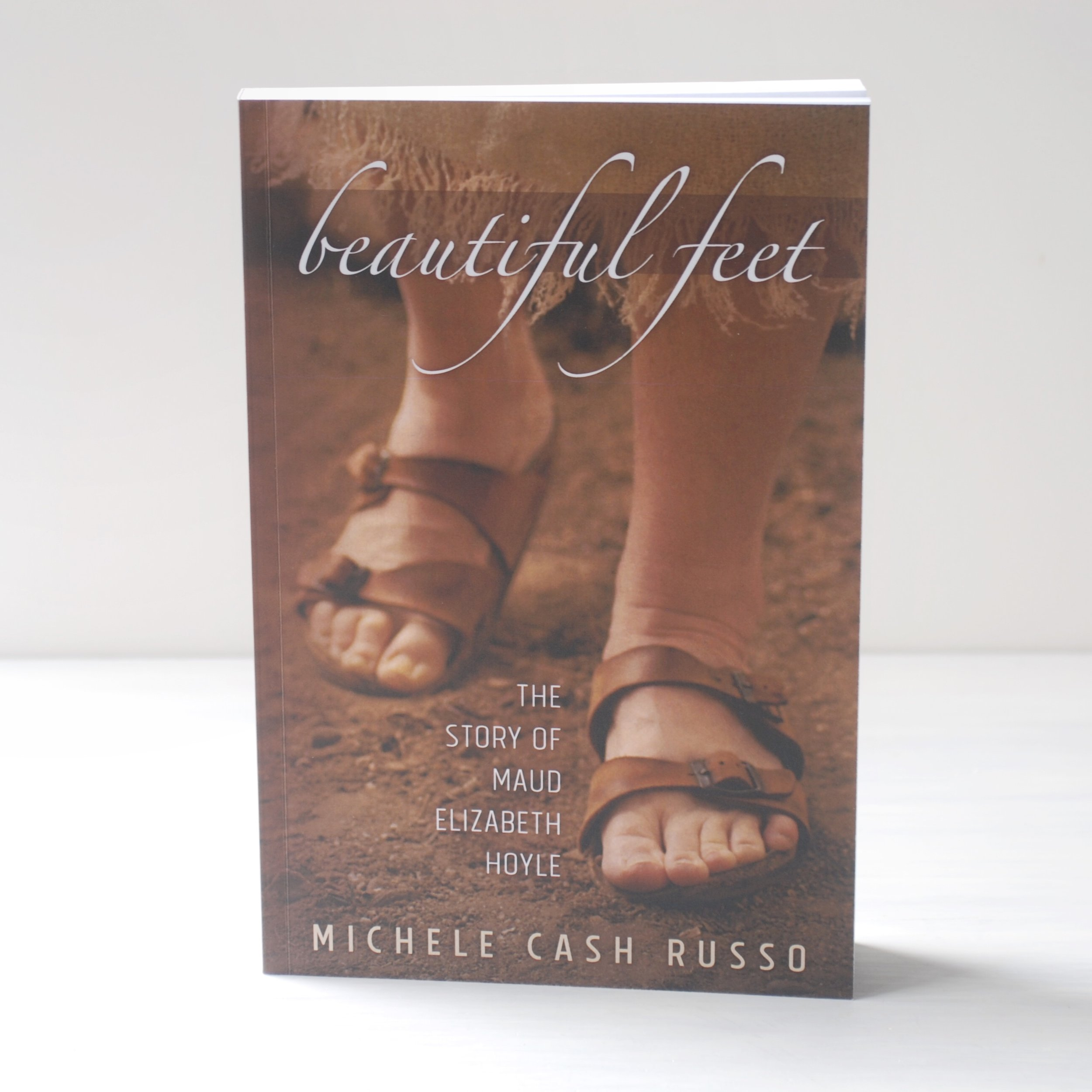 The author was thrilled with this book cover photo and design. She wanted an image of feet on a dirt path but it was the dead of winter, so I arranged for the local conservatory to let us use their desert room for a photo shoot.