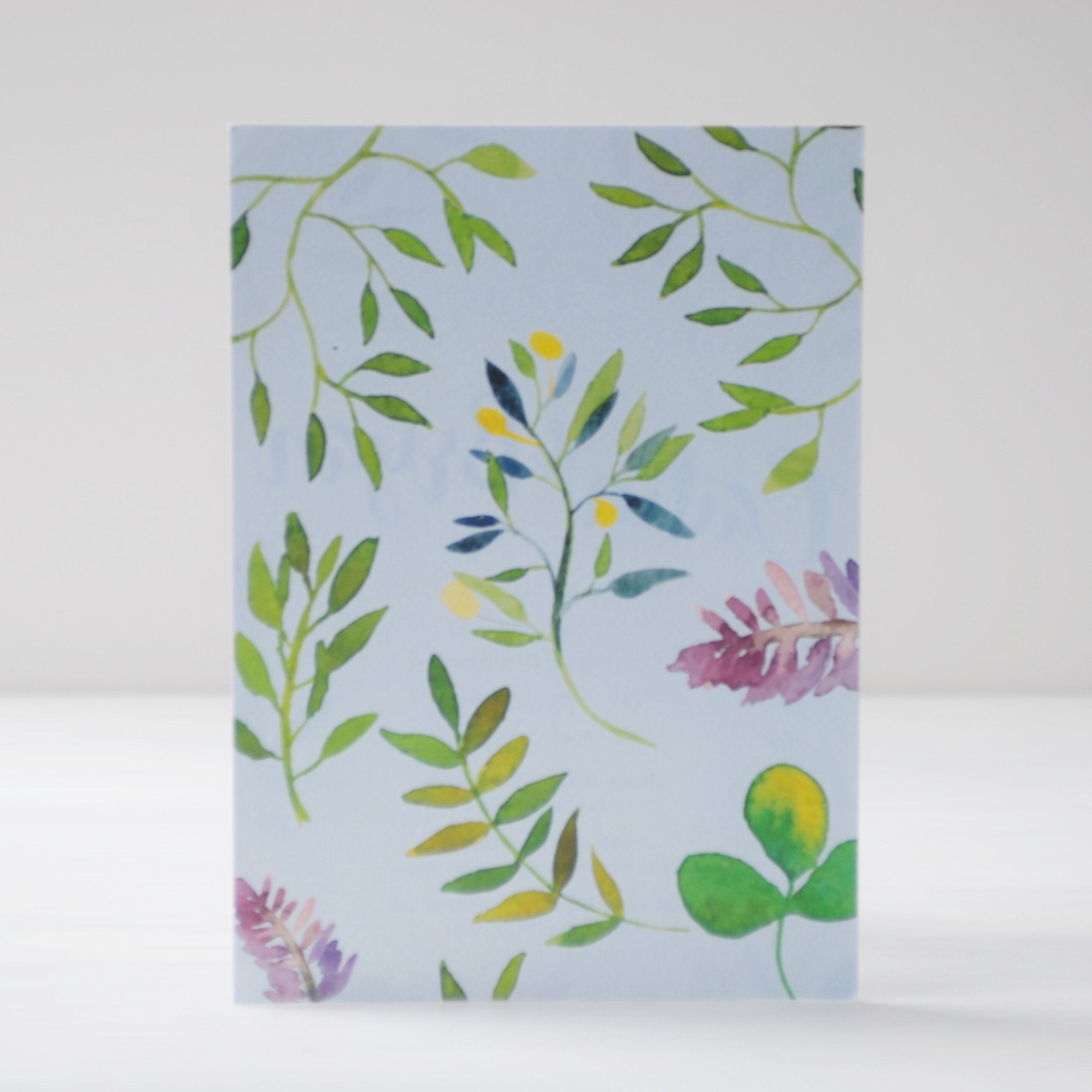 Flowers and leaves make a pretty pattern on the back of the invitation.