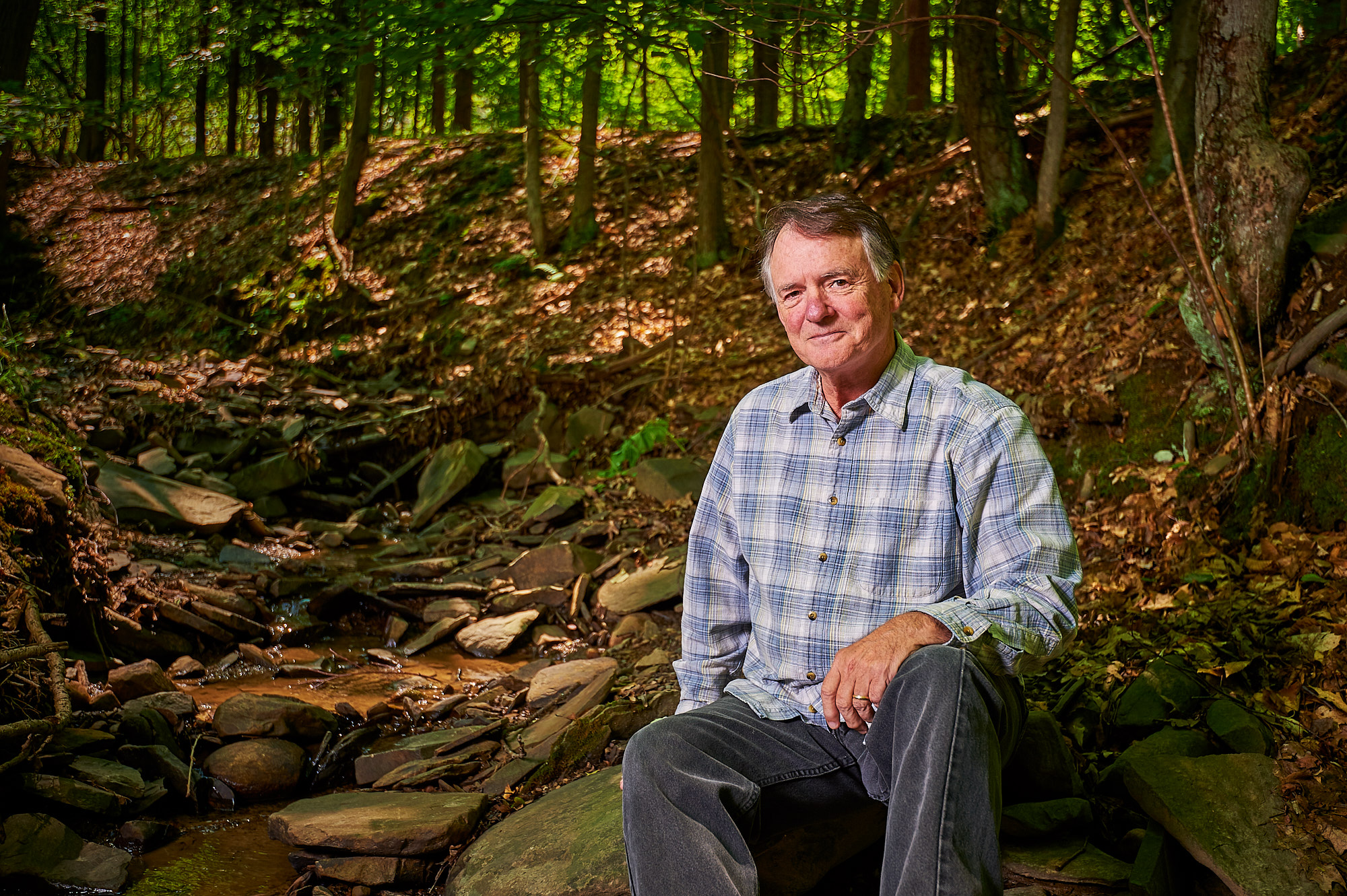 Rick Marsi, Naturalist, Photographer and Author, photographed beside a stream on his property in Vestal, NY
