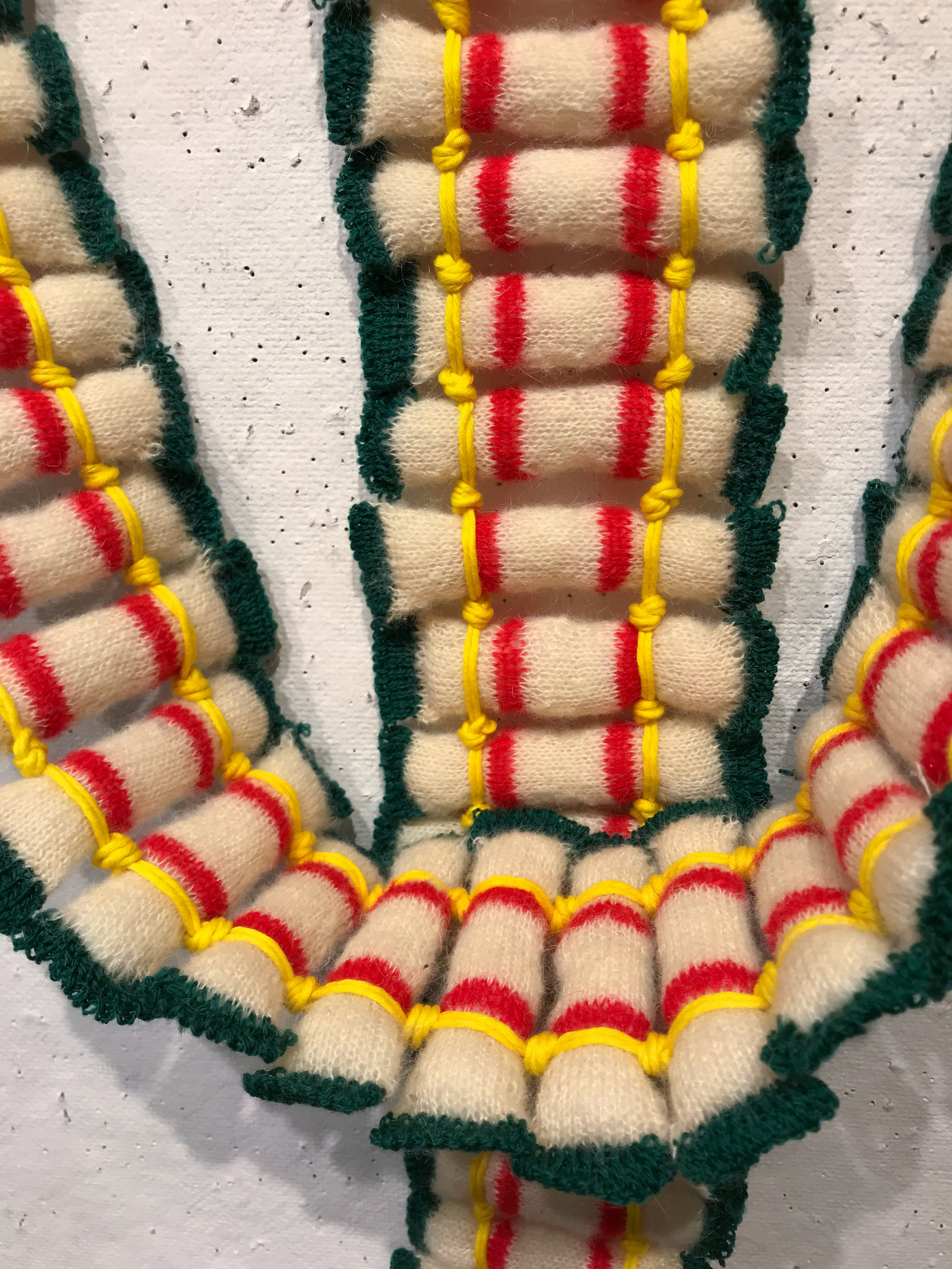 All of the tofus were knitted separately, and then tied together into strips.
