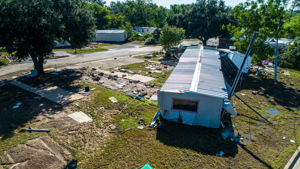 flood damage at a mobile home park. photo:Roschetzky Photography/shutterstock