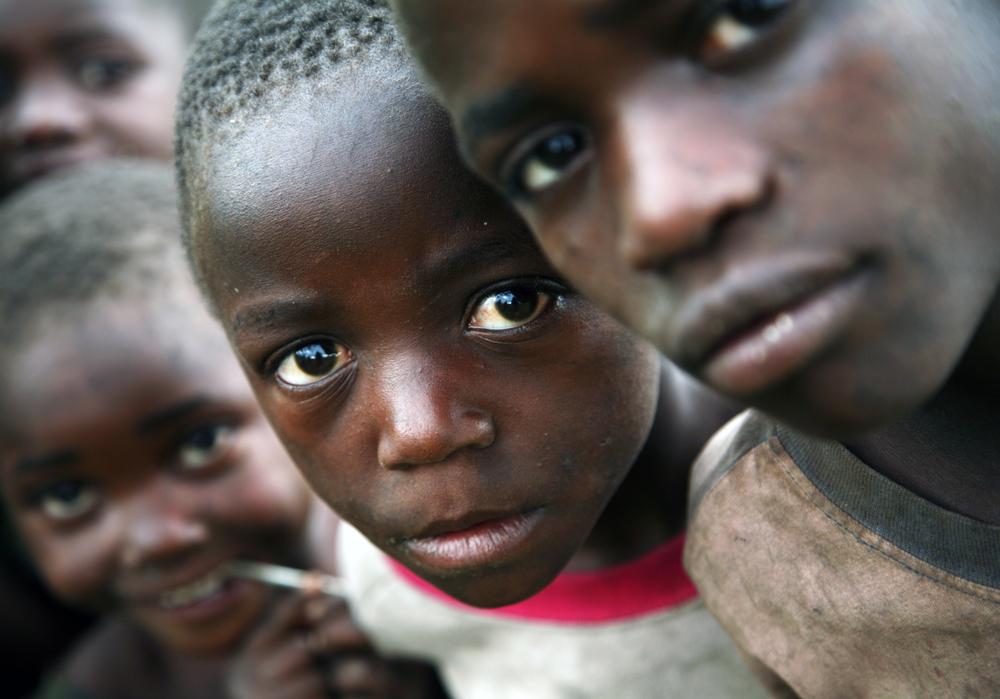 Congolese refugee children. photo:  Stuart Boulton/shutterstock