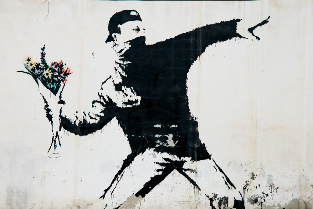 A mural by the British street artist Banksy in the West Bank. photo: Ryan Rodrick Beiler/shutterstock
