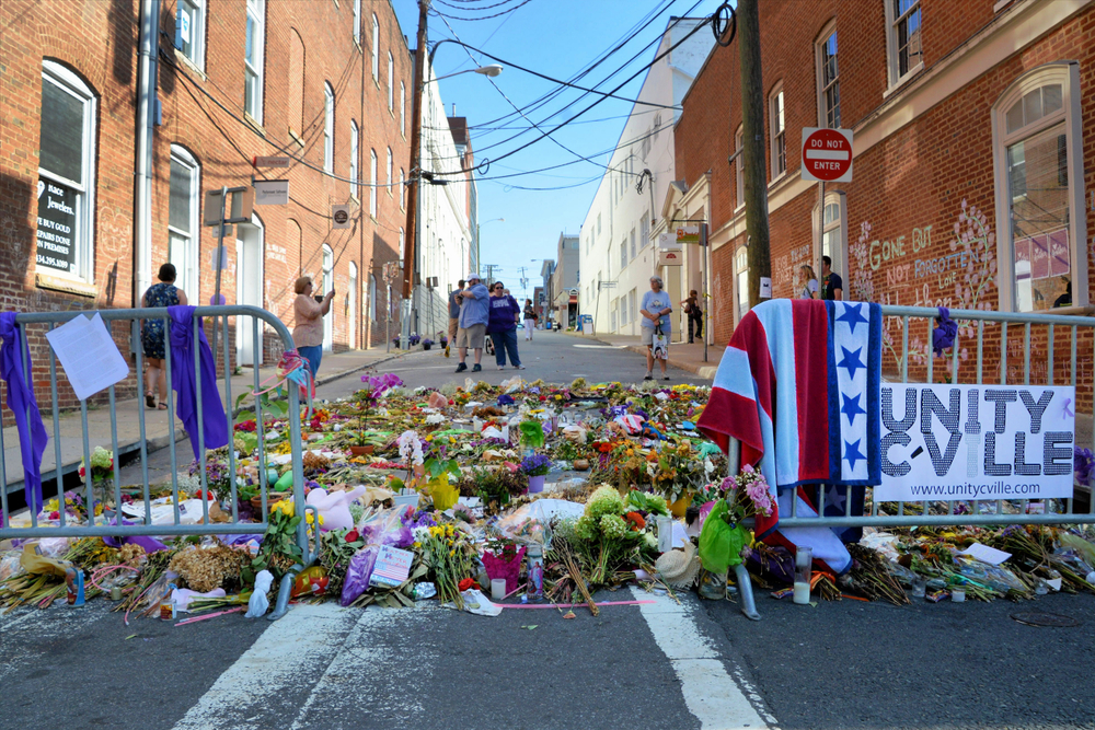 Memorial flowers at the spot where Heather Heyer was killed and others were injured during racial violence in Charlottesville, VA last august. photo: Kim Kelly/shutterstock