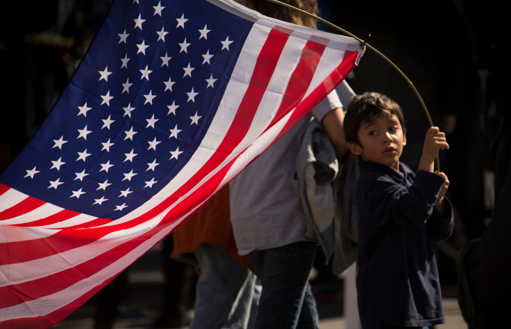An immigrant rights marcher in los angeles. MattGush/shutterstock