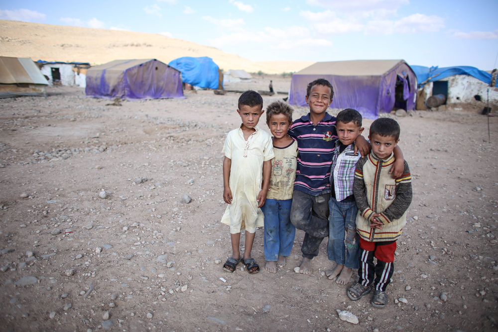 Syrian children at a refugee camp. Din Mohd Yaman/shutterstock