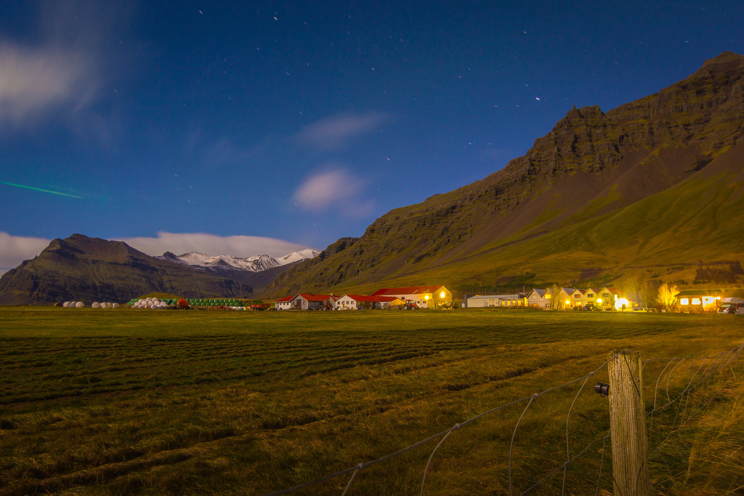 This shot was taken at 1AM in southern Iceland. I stood in the middle of a farm field hoping the northern lights would show. It never came and it wasn't until I processed this photo did I see the small green streak on the left. The next day, I overheard others who were some miles away talk about seeing the lights in full. If only I had rented a car.