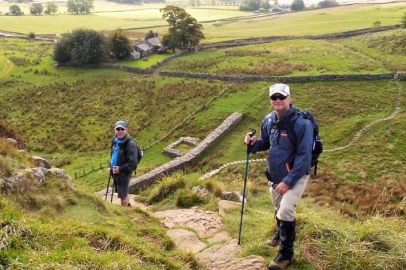 Hikers descending to Hadrian's Wall
