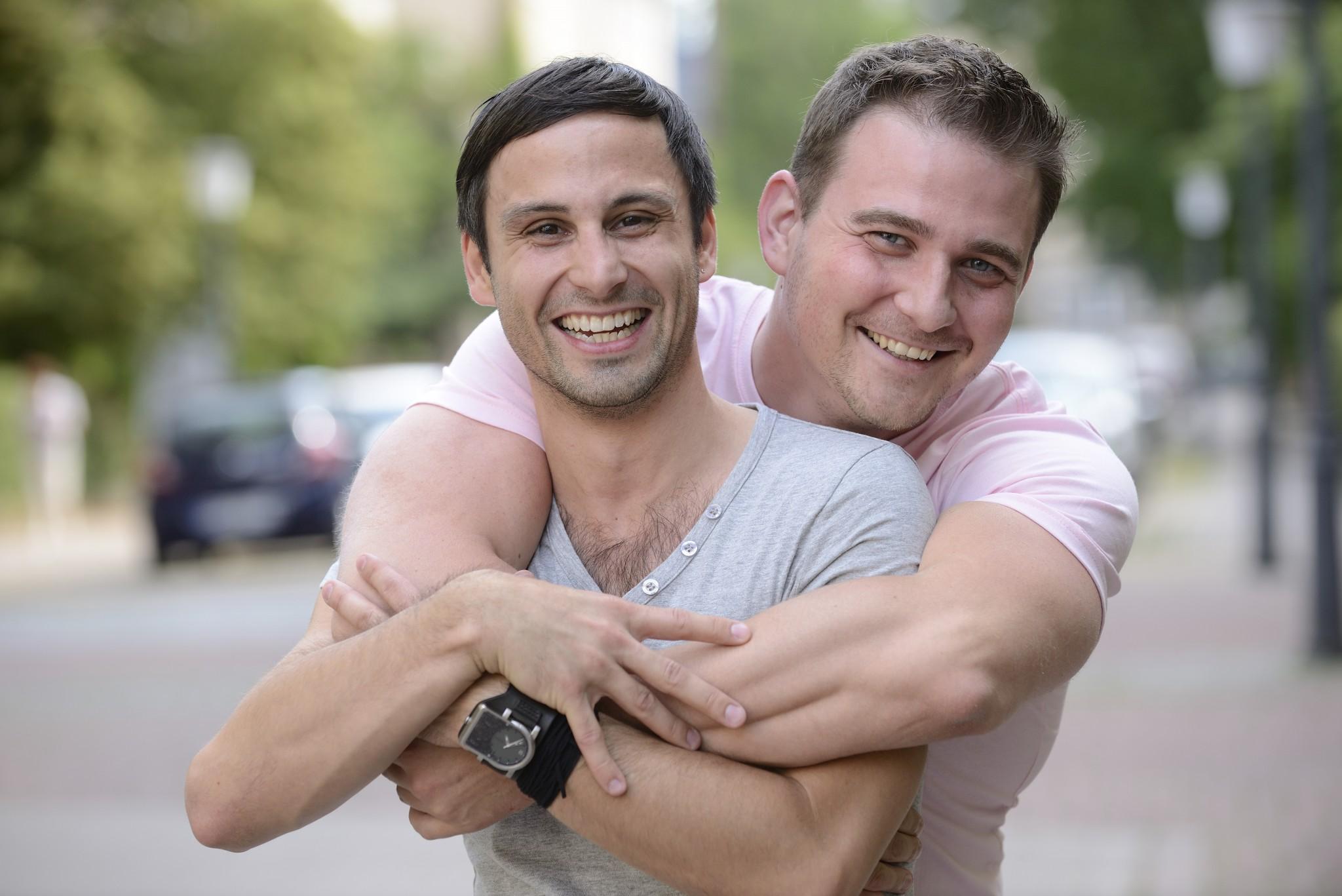 bigstock-Portrait-of-a-happy-gay-couple-34791707.jpg
