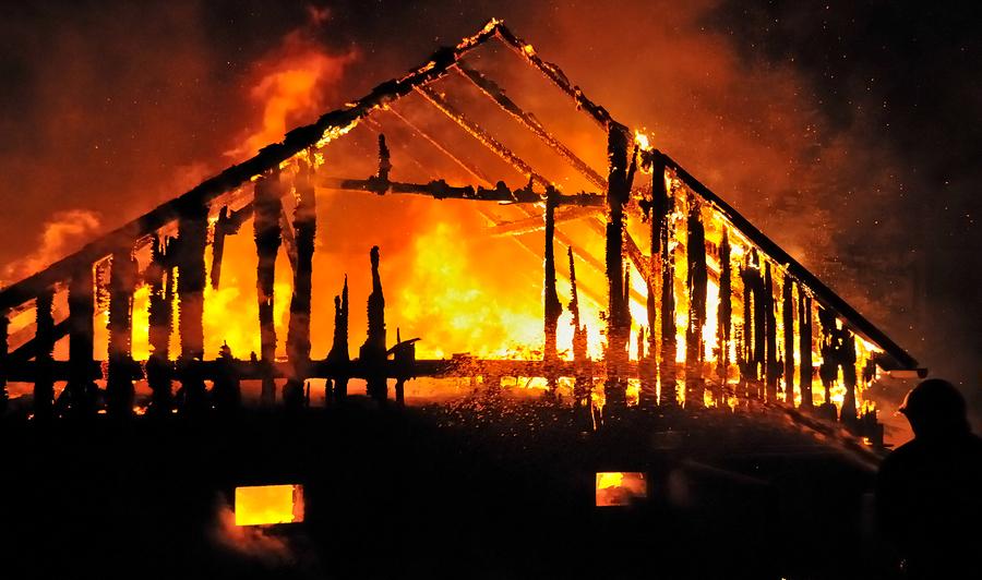 Timber house burning.jpg