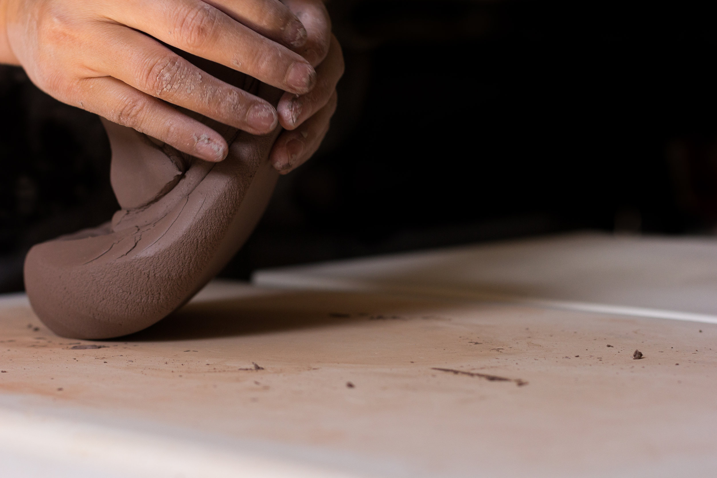 Wedging stoneware. Photograph by Jack Li.
