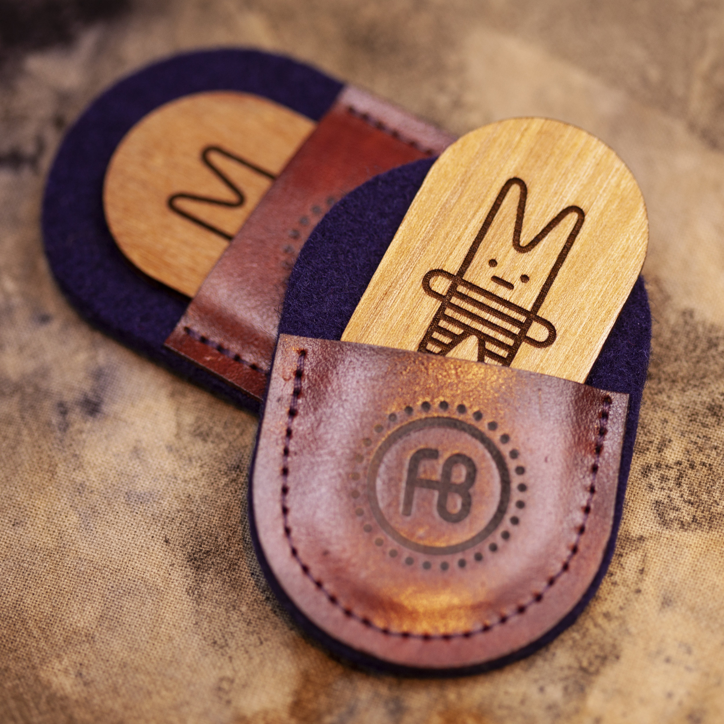 Leather/wood/wool hang-tags