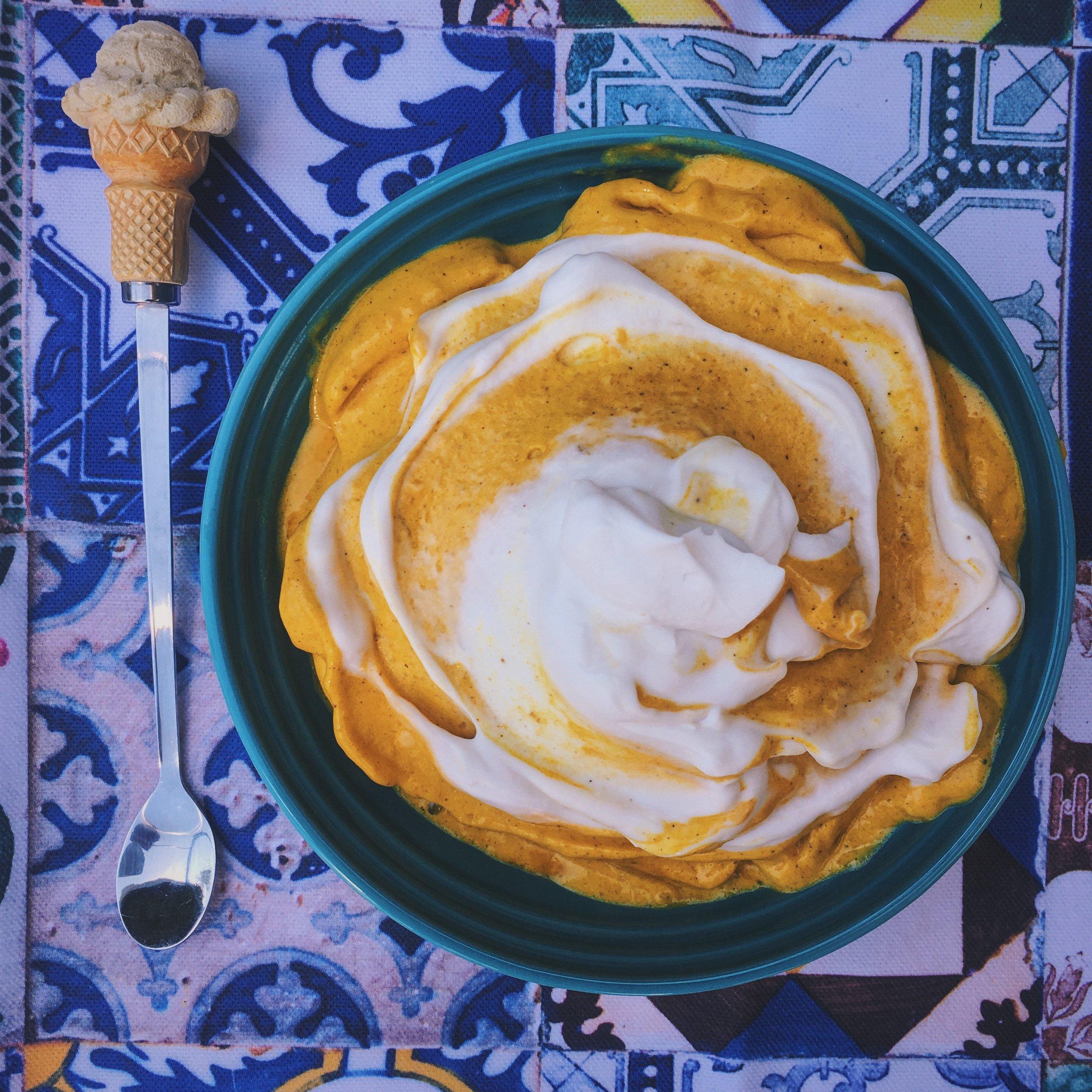 healthy vegan frozen banana ice cream made with turmeric, coconut yoghurt, maca and cinnamon
