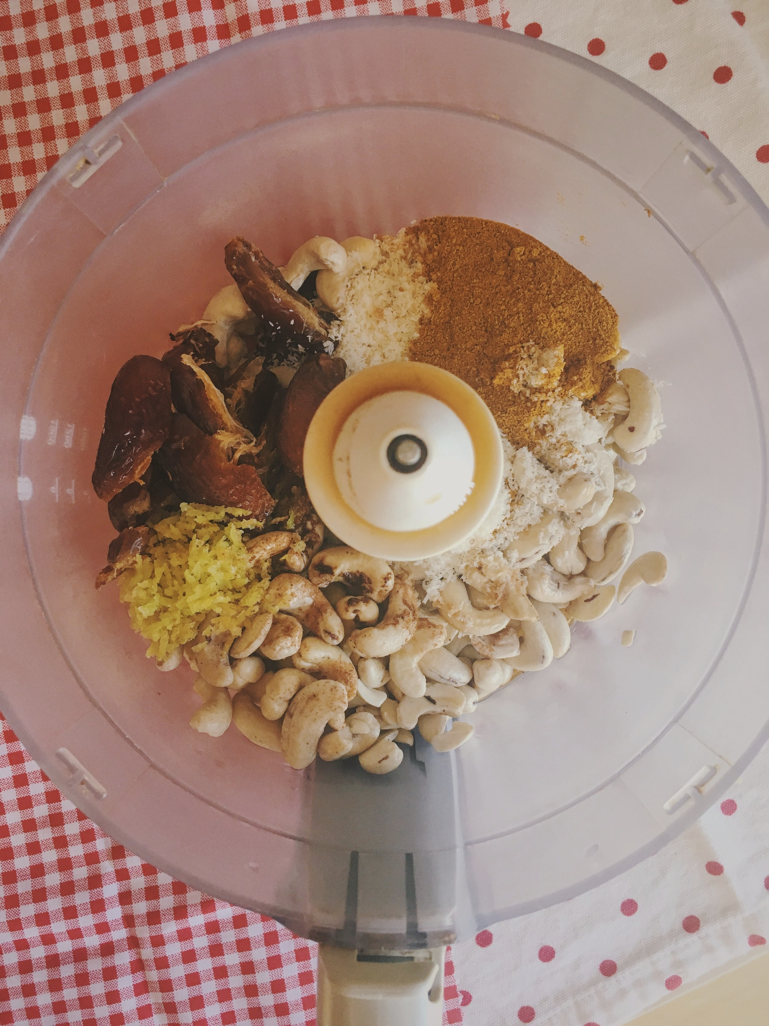 cashews, dates, lemon zest, cinnamon, coconut, turmeric in the food processor