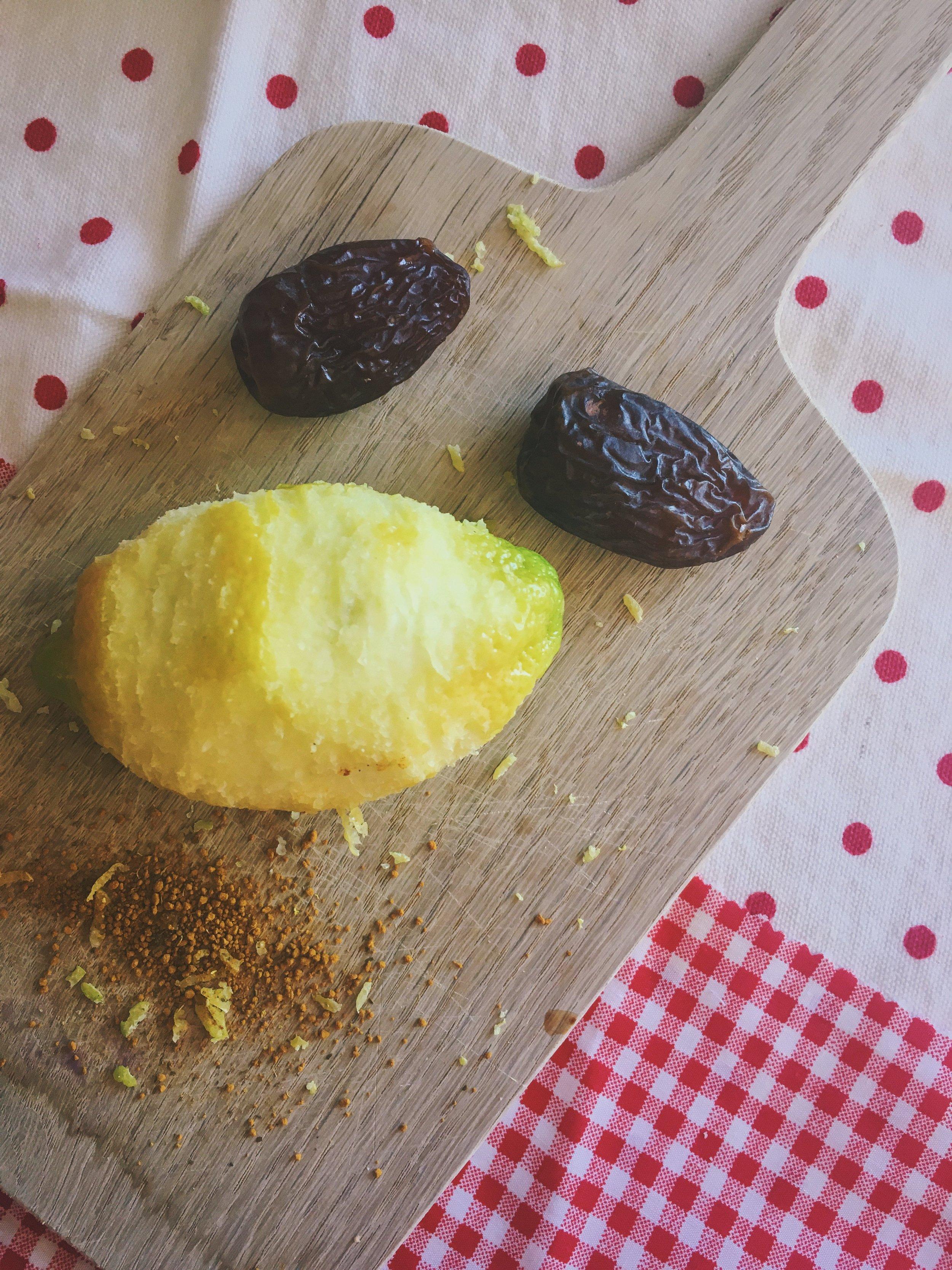 lemon zest, medjool dates and turmeric on a wooden board