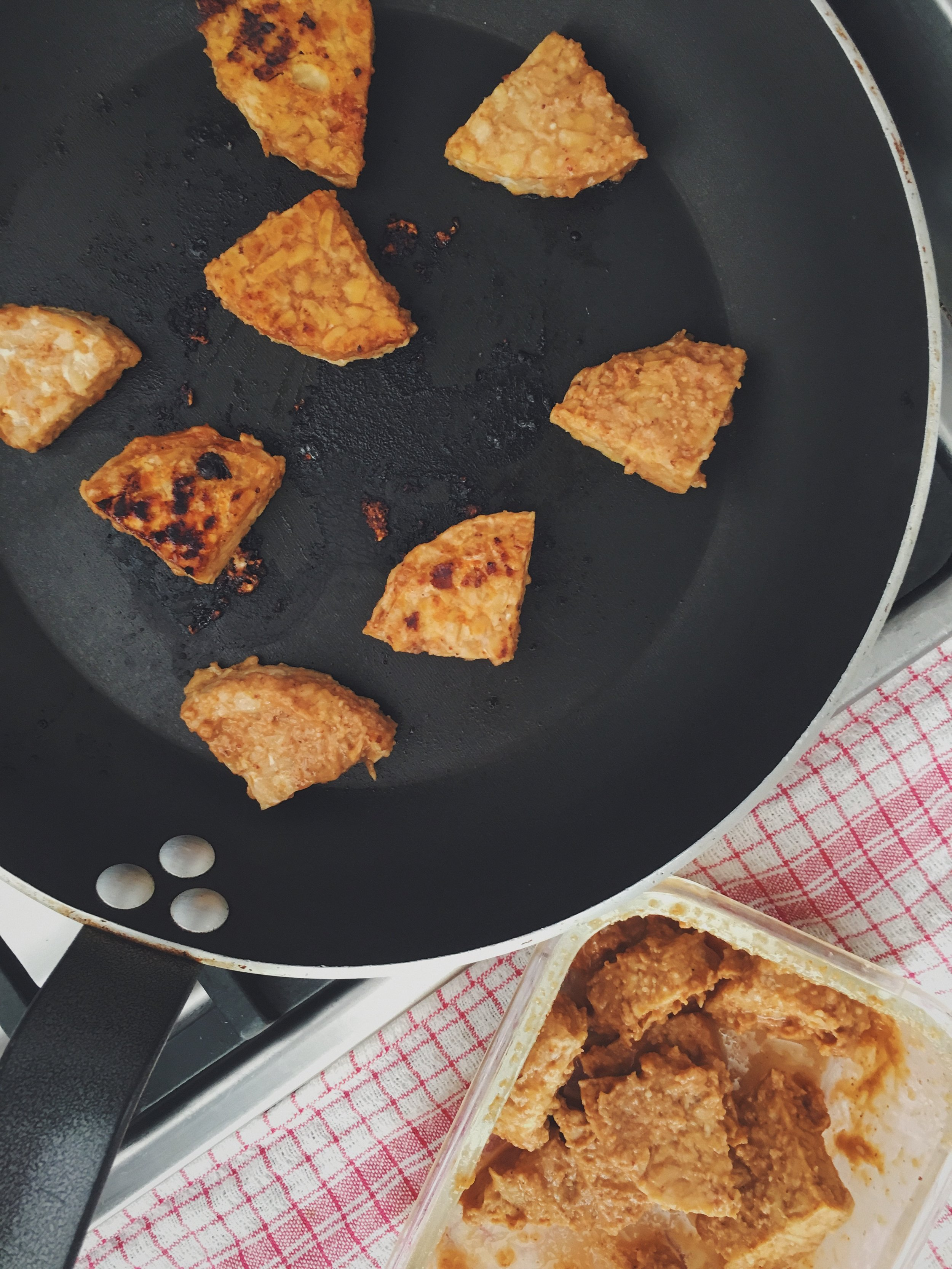 fried tempeh cooking a pan