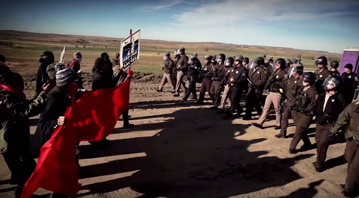 Still from the Music Video Stand Up/ Stand N Rock #NoDAPL, directed by Johnny Lee